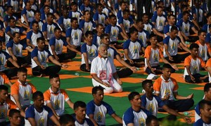 Strike a pose: International Yoga Day stretches around world