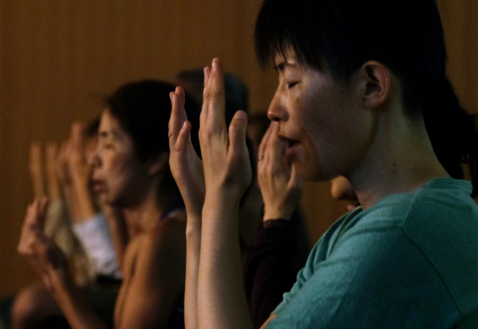 Yoga practitioners meditate during a special yoga session to mark International Yoga Day at Tokyos Zojoji Temple on June 21, 2018. Photo by AFP