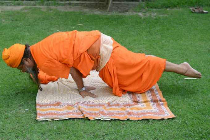 Easy if you know how: People around the world are celebrating International Yoga Day, though not everyone will manage this pose. Photo by AFP