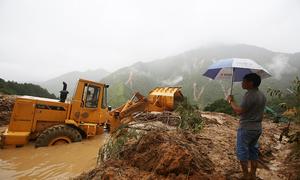 Landslides lay roads, homes to waste in northern Vietnam