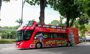 Hopping on and off a big red bus in Hanoi