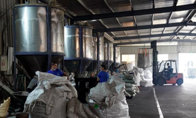 China's plastic recyclers go abroad as import ban bites