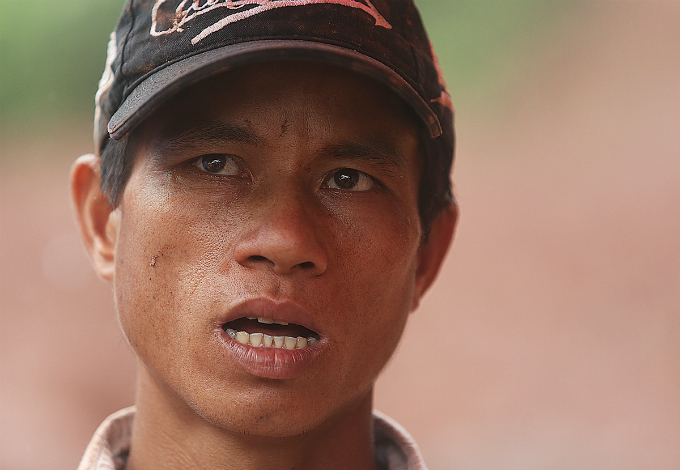 After ten days of raining, the three mountains surrounding the valley suddenly fell down in the afternoon of Sunday in the blink of an eye, Lo Van Sanh, 42, who is still looking for his wife and daughter, says.