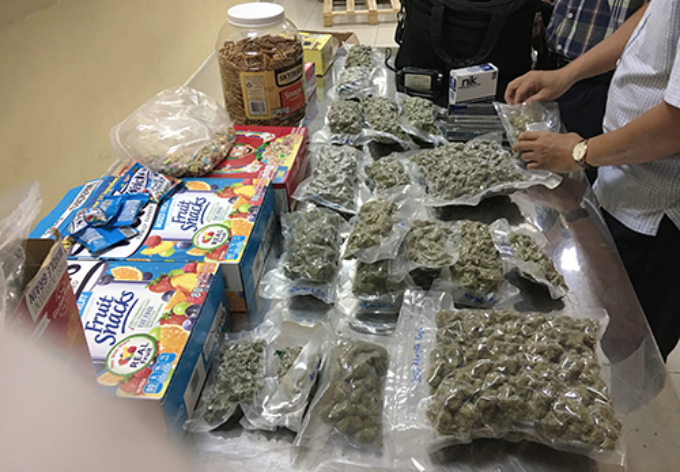 Marijuana hidden in confectionary packages from the U.S. is seized at Tan Son Nhat Airport. Photo courtesy of Ho Chi Minh City Customs