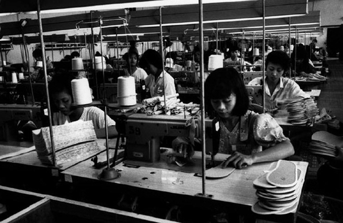 Making shoe soles in a factory.
