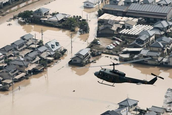 Rescuers race to find survivors after Japan floods kill over 100