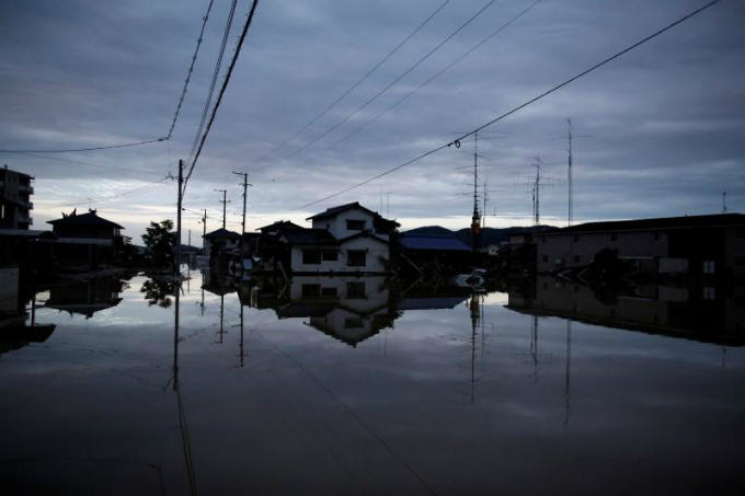 Submerged houses are seen in a flooded area in Mabi town in Kurashiki, Okayama Prefecture, Japan, July 8, 2018. Photo by Reuters/Issei Kato