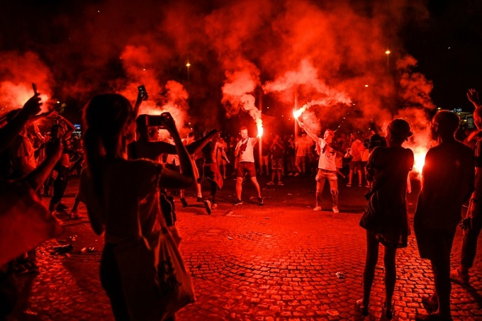 Fans celebrated with flares after Frances World Cup victory. Photo by AFP