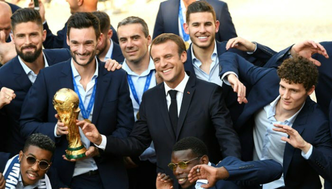 President Emmanuel Macron celebrates with the victorious French side. Photo by AFP/Lionel Bonaventure