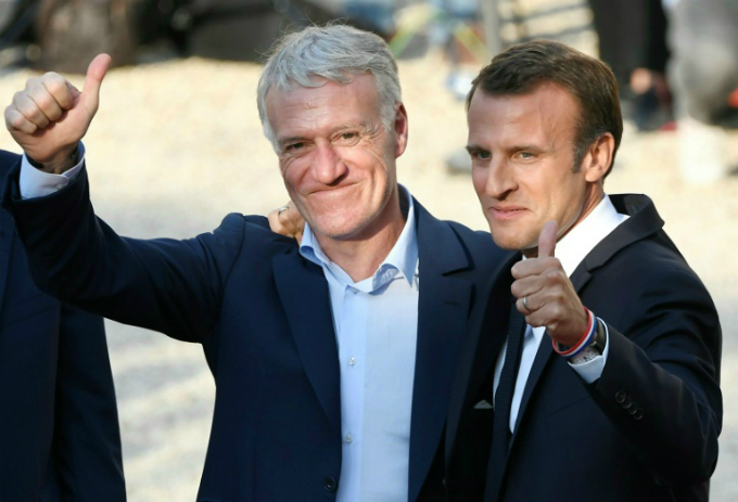 French President Emmanuel Macron (R) and coach Didier Deschamps give the thumbs up at the Elysee Palace. Photo by AFP/Lionel Bonaventure