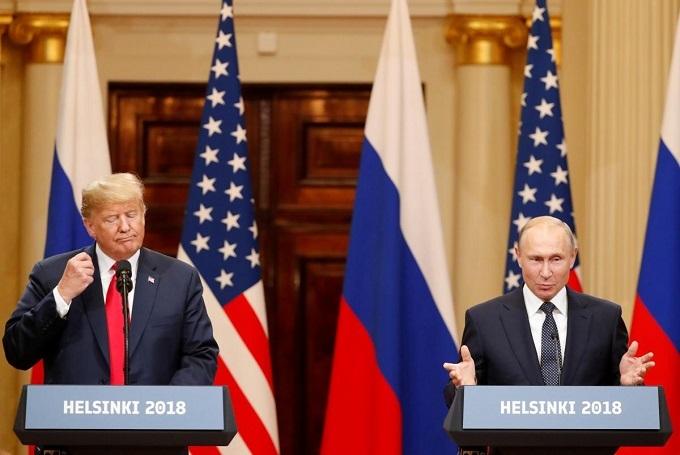 Trump backs Putin on election meddling at summit, stirs fierce criticism