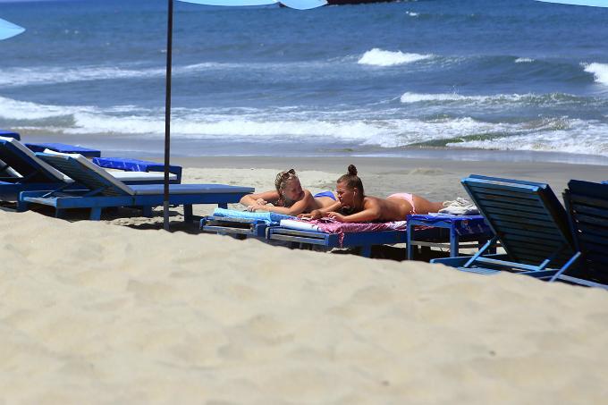 Tourists sunbathe at Cua Dai Beach in Hoi An. Photo by VnExpress/Nguyen Dong