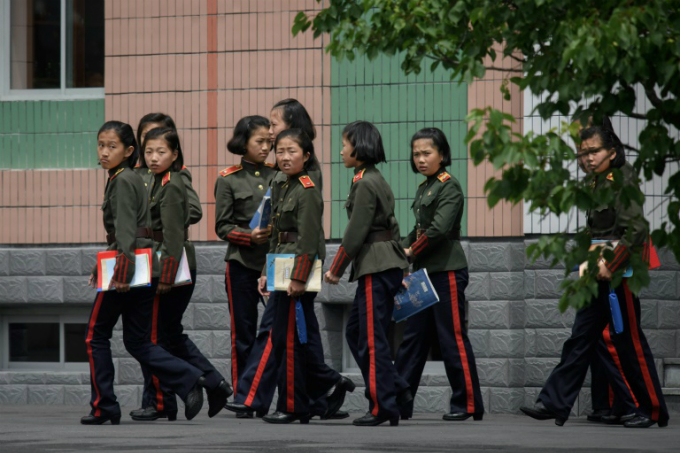 Pupils at the elite schools wear a military-style uniform said to have been designed by North Korean founder Kim Il Sungs wife Kang Pan Sok, a red line down their trousers symbolising their devotion to the cause of revolution
