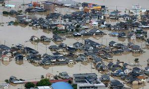 Typhoon barrels towards flood-hit western Japan
