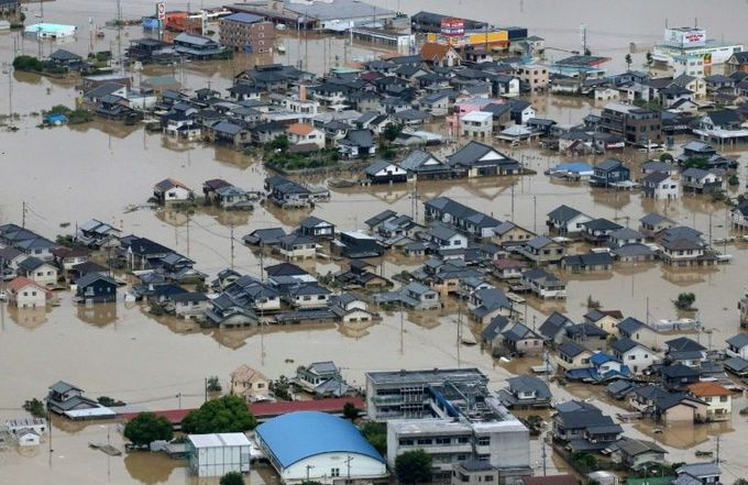 Typhoon barrels towards flood-hit western Japan