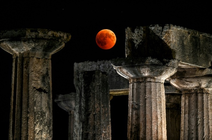 Observers in the Greek city of Corinth enjoyed prime views of the blood moon over the temple of Apollo. Photo by AFP