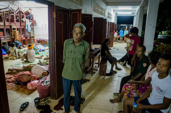 At night, while some kids and adults sleep, others stay awake in the corridor.
