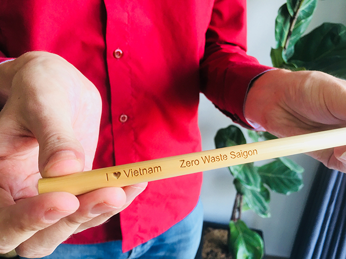 Zero Waste Saigon offers reusable straw made ouf of steel, bamboo, glass and green grass as sustainable alternatives to single-use plastic straws. Michael Burdge showed a bamboo straw at his appartment partly turned into storage place on July 24, in District 4, Ho Chi Minh City. Photo byHanh Pham.