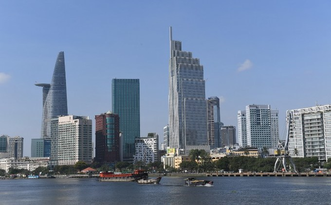 High-rise buildings in the center of Ho Chi Minh City are seen from across the Saigon River. Photo by AFP/Hoang Dinh Nam