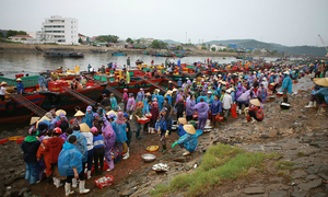A seafood market in central Vietnam explodes in monsoon colors
