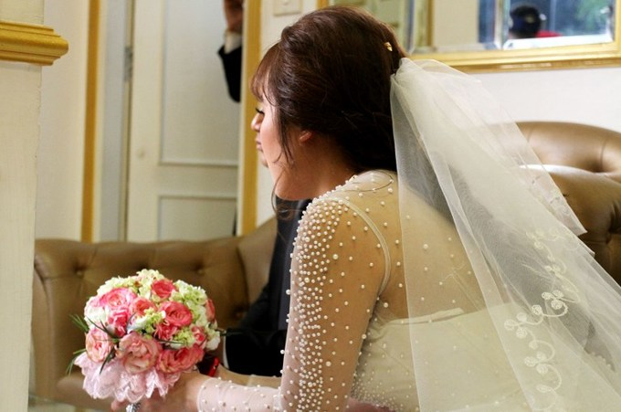 A bride waits for her wedding ceremony in Hanoi. Activists believe that women in Vietnam are not duely protected in cases of sexual harassment. Photo by AFP