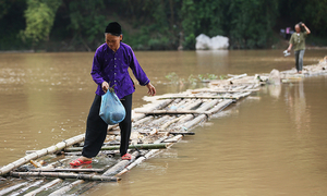 Villagers in northern Vietnam use bamboo to walk on water