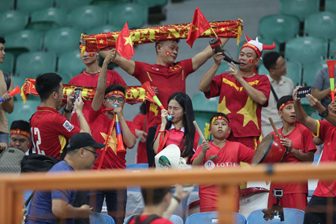Vietnamese fans cheer at the stadium in Indonesia.