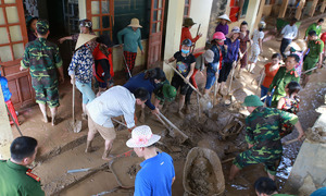 Central Vietnam province struggles to clear mud left by flash floods