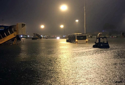 Tan Son Nhat Airport is submerged after a heavy downpour, as seen in a file photo by VnExpress