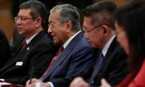 Mahathir says China will sympathize with Malaysia's problems