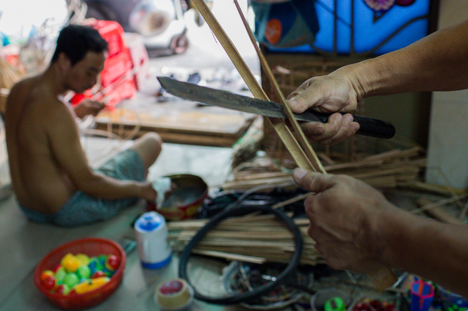 It takes a lot of time to finish a giant lantern, said Thanh. We usually finish our products a month before the festival, but we start preparing bamboo, transparent plastic sheets and other materials since the beginning of the year, Thanh said as he briskly sliced bamboo sections.