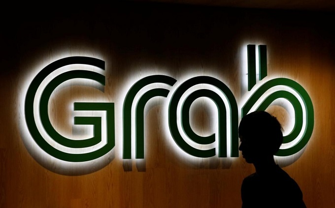Traditional taxi firms batten down the hatches in battle against Grab
