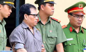 Vietnam jails two American subversives for 14 years