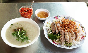 Try amazing duck salad and congee in Saigon