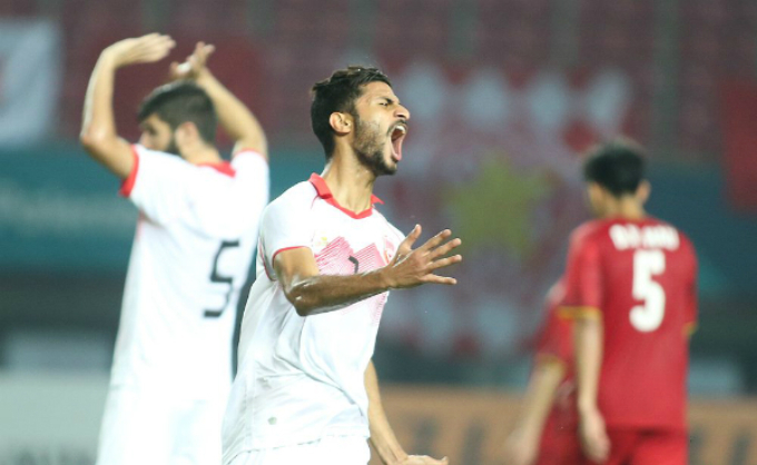Bahrain players react after their goal from an offside position was not accepted.