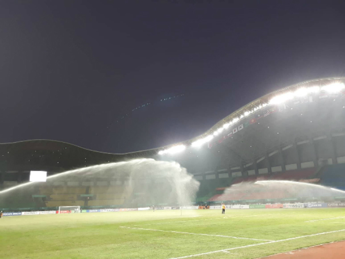 The stadium is watered ahead of the game.