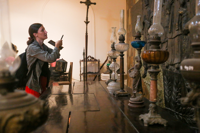 A curious English visitor taking photos and reading information about the lamps. Most of the lamps in the ehibition were made in the late 19th century, up until the end of the 20th century, originated from villages known for their ceramic tradition such as Bat Trang (near Hanoi), Lai Thieu (a ward of Binh Duong Province, Southeast region of Vietnam),....