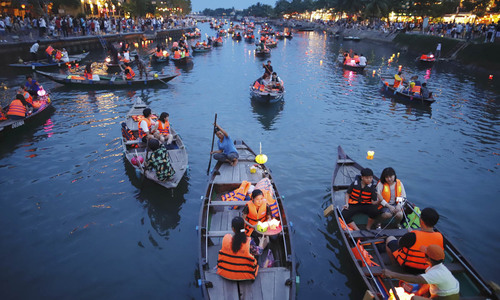 Central Vietnam river glows in a tribute to parents