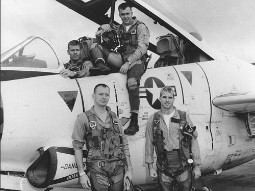 U.S. Navy Captain John McCain (standing on the right). Photo by US Navy