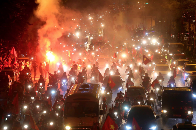 Flares for the celebration in Hanoi. Photo by Ba Do