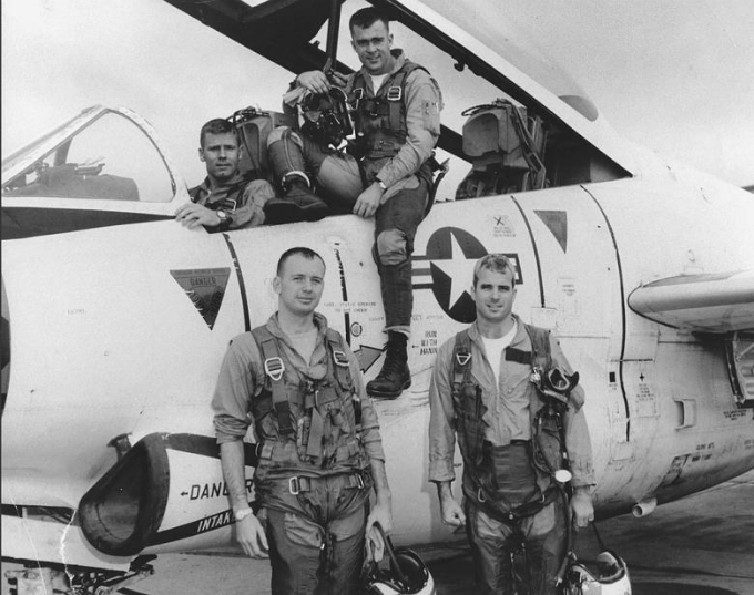 John McCain (bottom R) poses with his U.S. Navy squadron in 1965. National Archives/via Reuters.