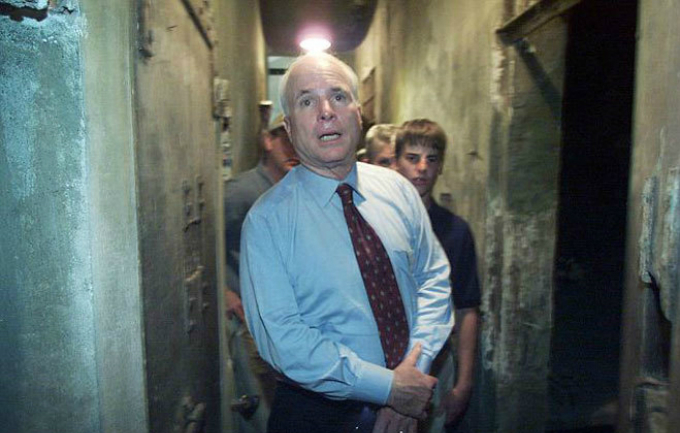 John McCain visits Hoa Lo Prison in 2000. Photo by Reuters