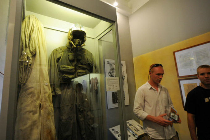 John McCains flight suit is displayed at the Hanoi Hilton, now a museum in the Vietnamese capital. Photo by AFP/Hoang Dinh Nam