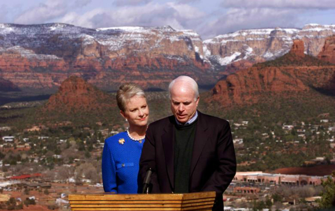 Set against the dramatic landscape of Sedona, Arizona, John McCain looks down while announcing his withdrawal from the Republican presidential primary in March 2000, following disappointing results on Super Tuesday. Photo by Reuters/Kevin Lamarque