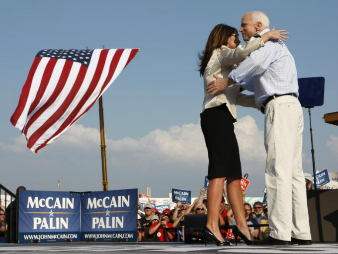 John McCain and his running mate Alaska Governor Sarah Palin hug during a campaign stop in OFallon, Missouri, August 2008. Photo by Reuters/John Gress