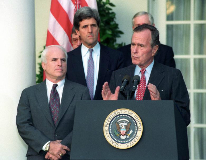 President George H.W. Bush addresses reporters at the White House on the release of documents by Hanoi on Americans missing in Southeast Asia. Bush, with Senators John McCain and John Kerry, said the information will allow the United States to begin writing the last chapter of the Vietnam War. Photo by Reuters/Mike Theiler
