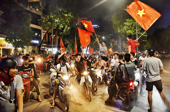 People celebrating Vietnams victory last week. Photos by VnExpress/Giang Huy