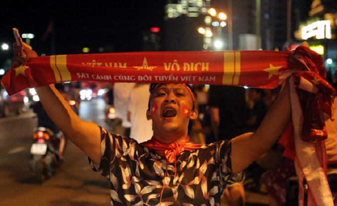 In the coastal city of Nha Trang in central Vietnam, fans flocked to downtown streets, screaming, Vietnam! Vietnam! Vietnams the Champion!Vietnamese players scored an outstanding goal, one man said.  Photo by VnExpress/Xuan NgocA family of four members on a motorbike in Saigon mingles with the teaming crowds.Saigon fans cheer as Nguyen Van Toan found the oppositions net in the 108th minute.