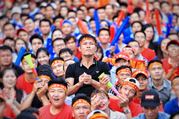 On Nguyen Hue walking street in Saigon, fans react as South Korea score their first goal of the game. Photo by Huu Khoa