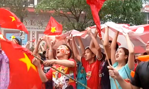 Diehard Vietnam fans ignore heavy rain to cheer team